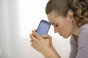 woman with cell phone (Alliance, ThinkStock)