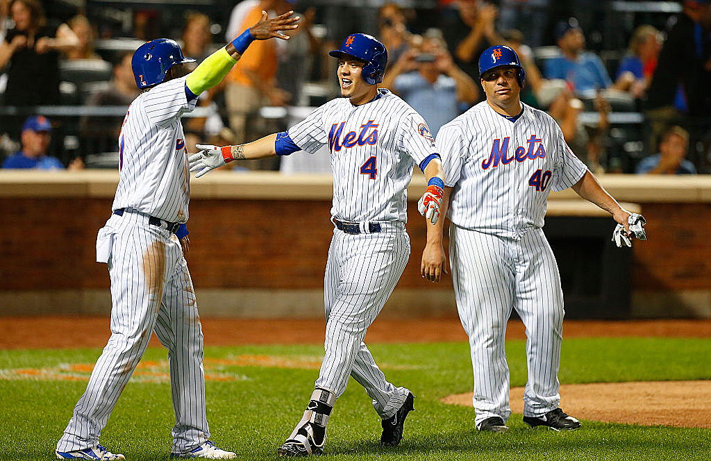 Colon, Mets win but can't gain any ground
