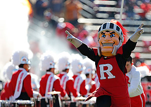 The Rutgers Scarlet Knight raises his arms before the team takes the field for a game