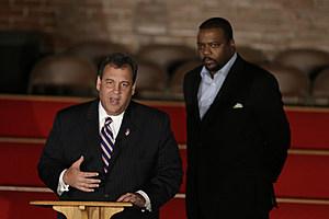 New Jersey Gov. Chris Christie, left, talks while New Hope Baptist Church pastor Joe Carter