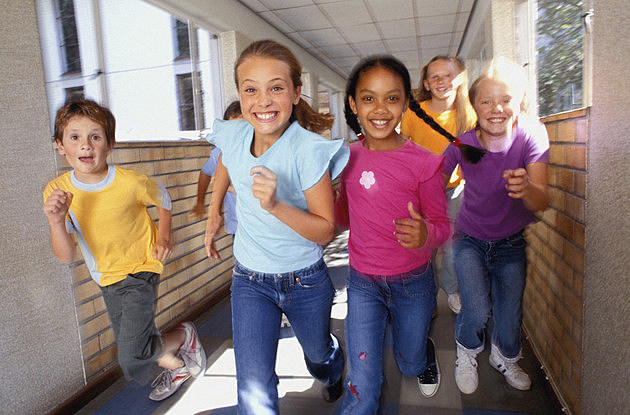 Children running through hallway