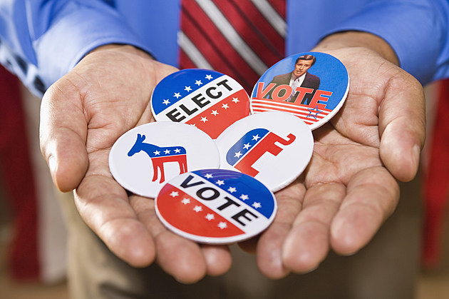 HoldingHolding political campaign buttons (ThinkStock)