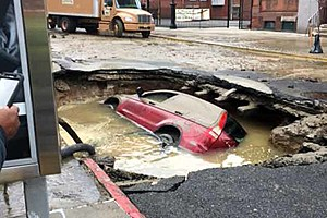 Car that fell into a sinkhole after a water main break in Hoboken