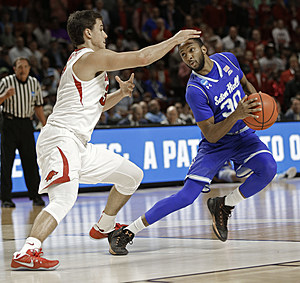 Seton Hall's Madison Jones (30) drives against Arkansas's Dusty Hannahs (3) during the second half in a first-round game of the NCAA men's college basketball tournament in Greenville, S.C.,