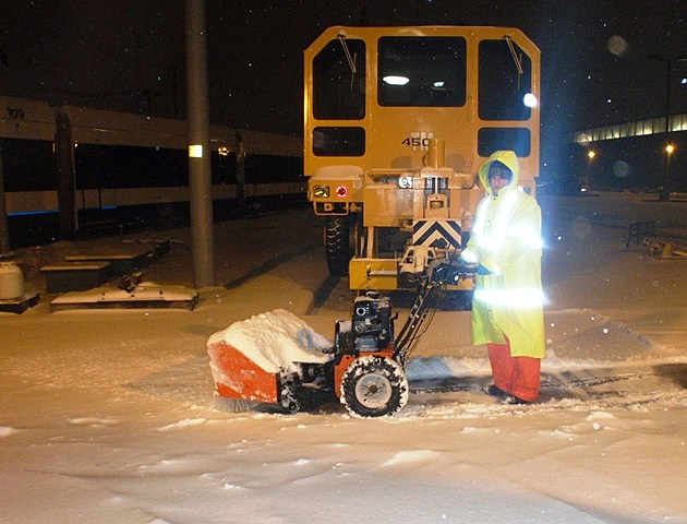 A NJ Transit worker clears snow in Maplewood