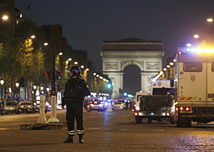 A police officer stands guard after a fatal shooting on the Champs Elysees in Paris, France