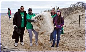 Brick Beach Volunteers with large foam plastic piece