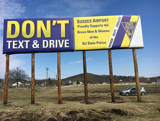 Sign neat Sussex Airport with a message about texting and driving