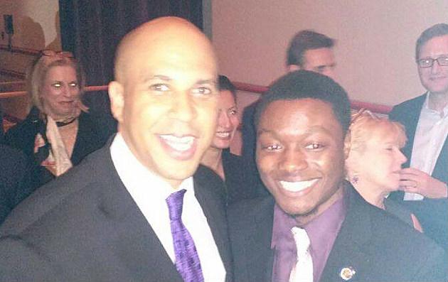 Mujahid Henry with U.S. Sen. Cory Booker in an undated photo. (via Mujahid Henry on Facebook)
