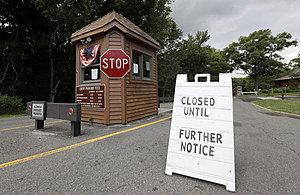 "A ""closed"" sign sits at the entrance of Cheesequake State Park"