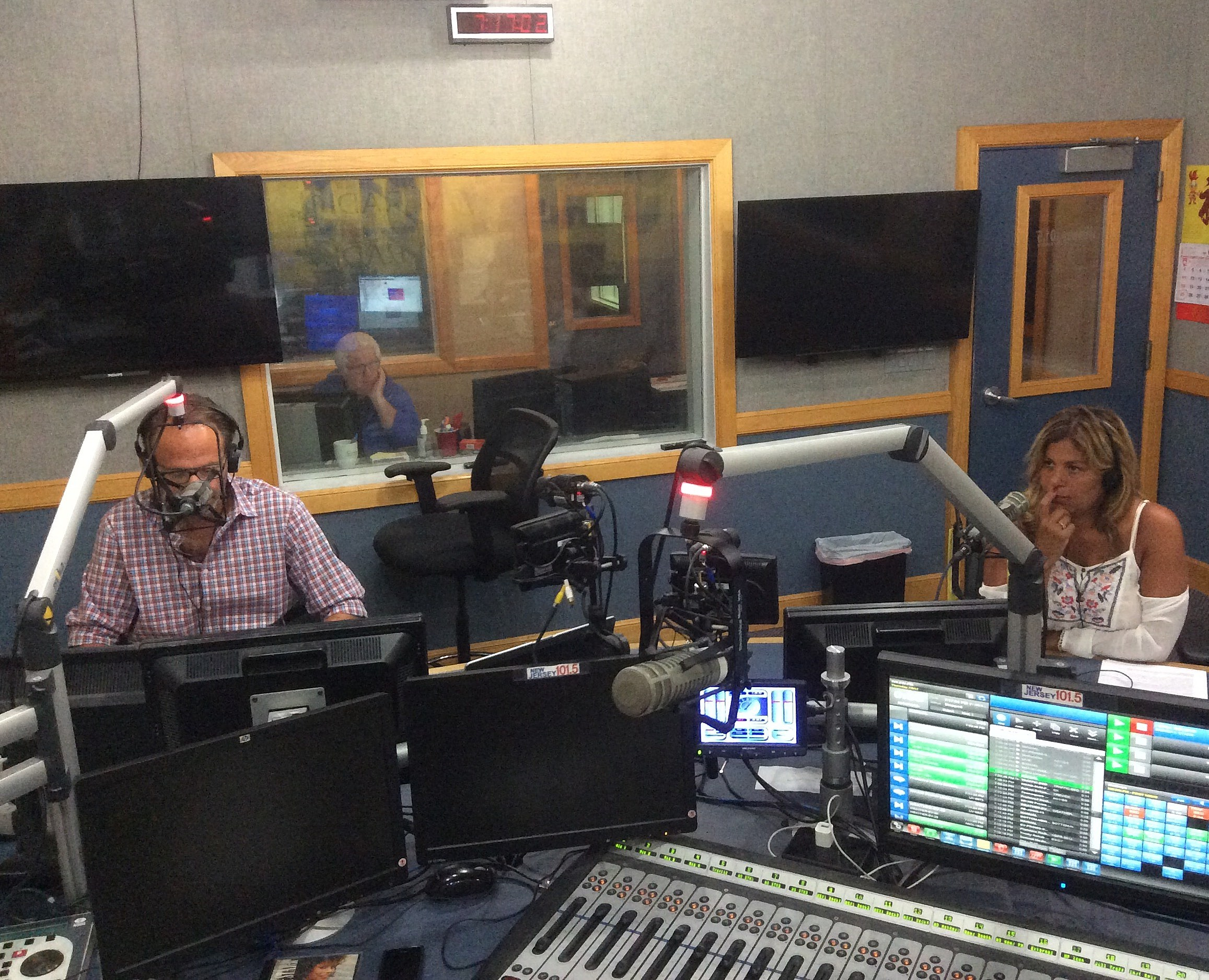 Jeff and Brenda listening closely to a caller. (Craig Allen photo).