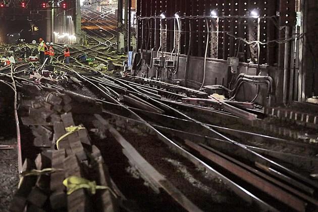 Amtrak workers repair tracks in New York's Penn Station
