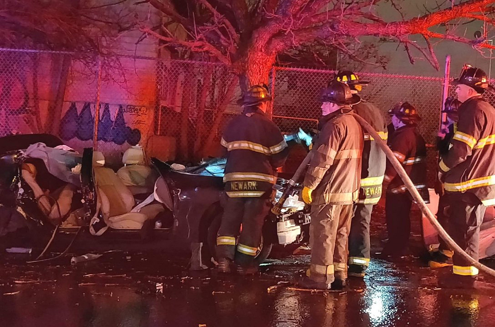 Car that struck a tree on 15th Ave in Newark